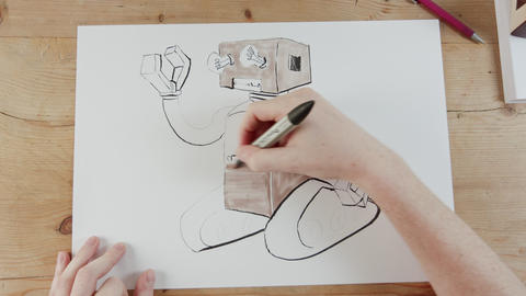 Timelapse of artist drawing a toy robot Footage