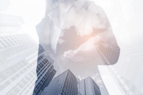 Double exposure of business woman show hand on business buildings background Photo