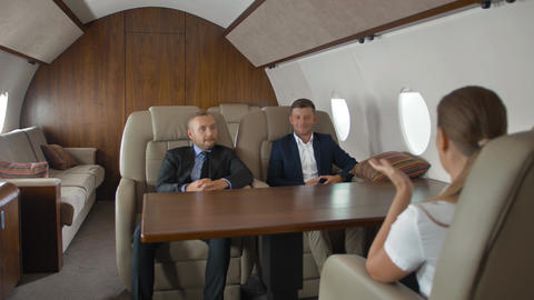 Businesspeople have meeting in corporate jet Footage