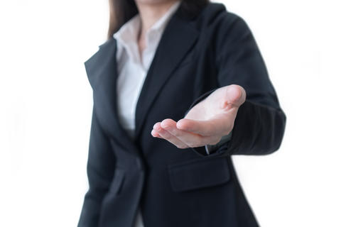 Business woman in black suit open hand for show something on white background Photo