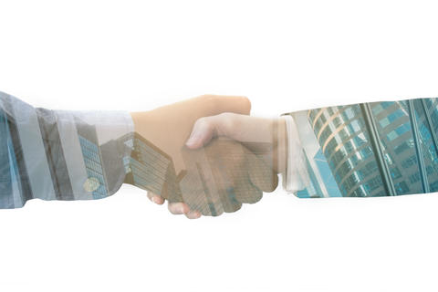 Double exposure handshake on city background for business successful フォト