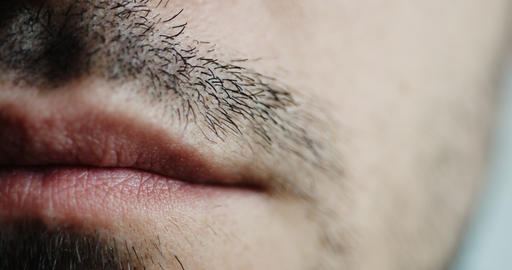 Men's short moustache and lips closeup ビデオ