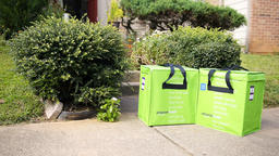 Amazon Fresh insulated grocery delivery bags, totes woman carrying inside home ビデオ