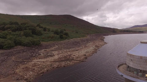 Llyn Celyn, aerial shot flying slowly away from the intake tower drought 2018 Live Action