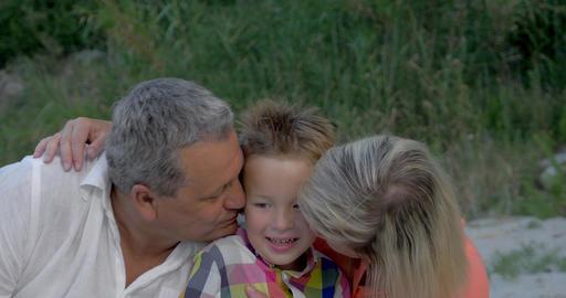Grandparents kissing dear grandson Footage