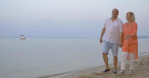 Enjoyable evening walk along the seaside Footage