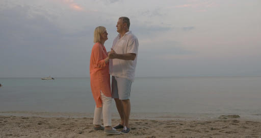 Senior couple dancing on the beach Footage