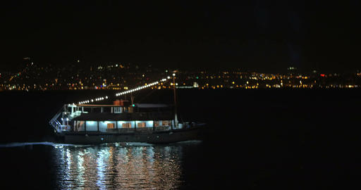 Boat Sailing by the City Waterfront at Night Footage