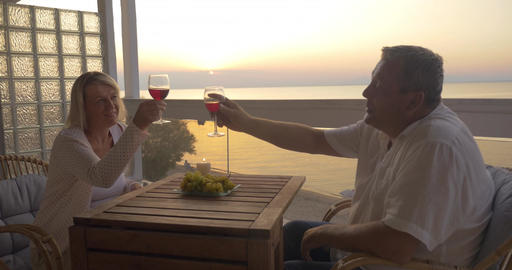 Mature couple spending time on drinking wine Footage