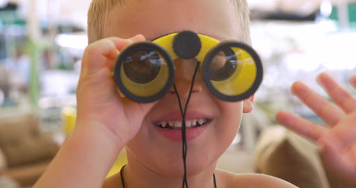 Child looking through the binoculars Footage