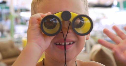Child looking through the binoculars Footage