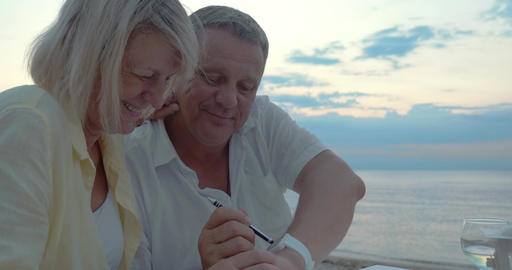 Man and woman using smart watch outdoor Footage