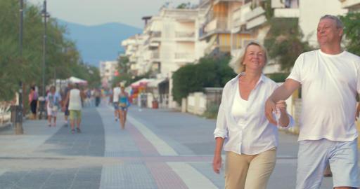 Couple having enjoyable walk on summer resort Live Action