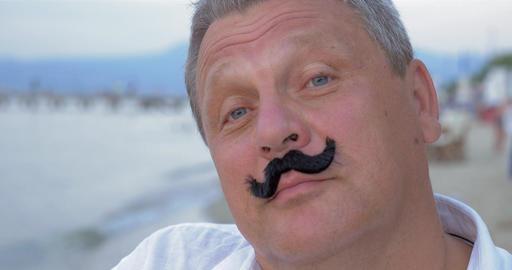 Senior man with fake mustache Footage