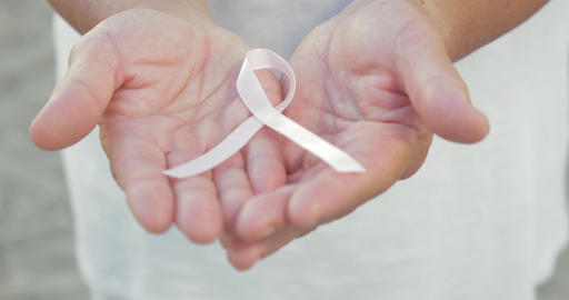 Open Hands Holding Breast Cancer Awareness Ribbon Footage