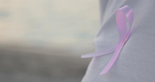 Pink Breast Cancer Awareness Ribbon on a Shirt Footage
