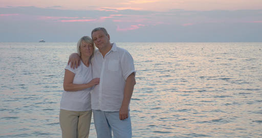 Senior couple by sea looking to the camera Footage