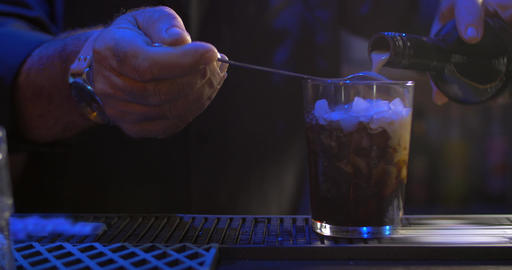 Bartender making alcoholic cocktail Footage