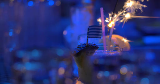Bar cocktails with sparkler and Greek flag Footage