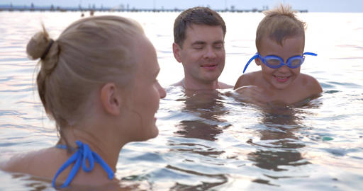 Family Playing with Swimming Toy in Sea Footage