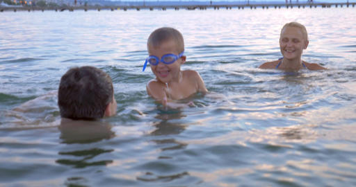 Boy Swimming in the Sea with Parents Footage