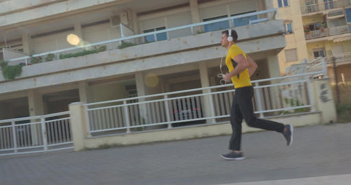 Man jogging with music in the morning Footage