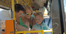 Child using fathers smartwatch during bus ride Footage