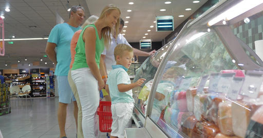 Family in front of Display Refrigerator in Supermarket Footage