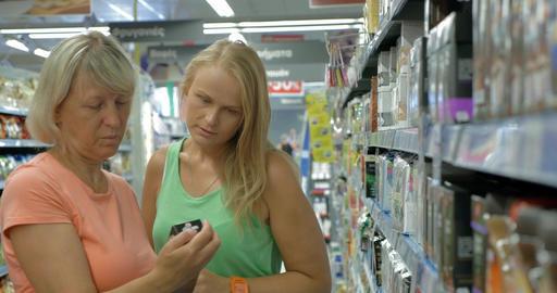 Women choosing tea in the supermarket Footage