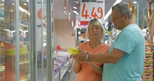 Senior couple choosing products in the store Footage