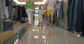 Family walking in clothing store Footage