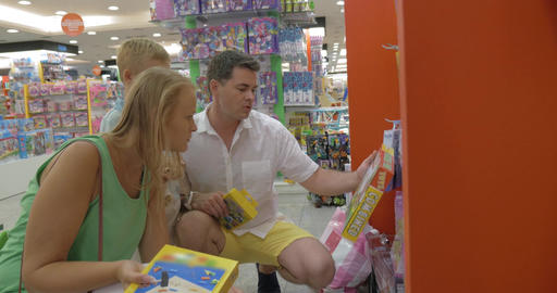 Parents buying toys for son in the store Footage