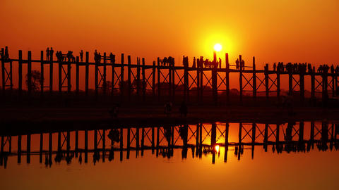 U-Bein teak bridge at sunset on lake, Mandalay Footage