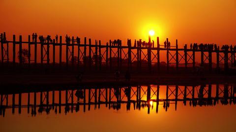 U-Bein teak bridge at sunset on lake, Mandalay Footage