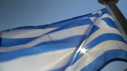Greek flag waving in the wind on sky background Footage