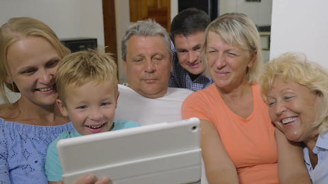 Family with child watching interesting video on pad Footage