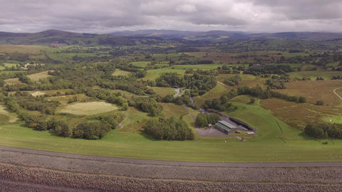 Llyn Celyn, aerial shot looking over the dam towards Welsh countryside Live Action