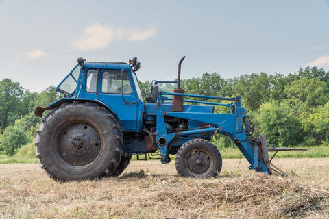 Tractor for working in the field and mowing grass Photo