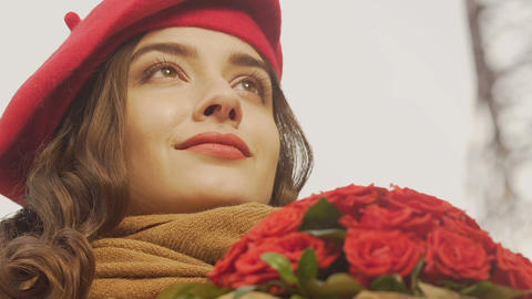 Inspired happy young woman waiting for lover, bouquet of roses, first date Live Action