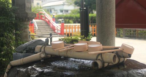 Purification trough at Kameido shrine in Tokyo medium shot 4K Live Action