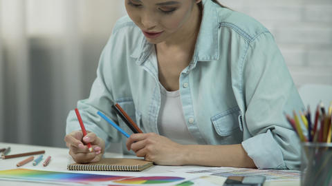 Asian woman drawing sketch of clothes, designer working as freelancer, fashion Live Action