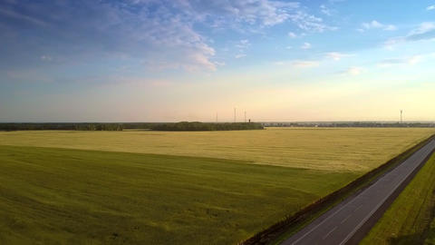 aerial motion from road over ripe fields under wonderful sky Archivo