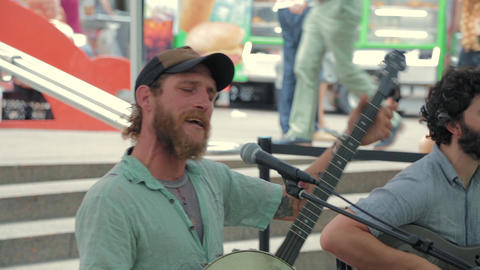Street musicians play country music in New York Footage