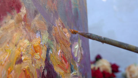 Close up of man's hand painting still life picture on canvas Live Action