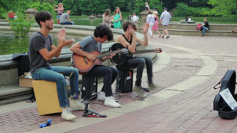 Street musicians play music in Central Park, NYC Footage
