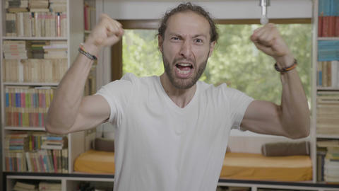 Young confident entrepreneur man raising arms feeling... Stock Video Footage