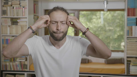 Astonished hipster man expressing mindblown gesture and reaction at home mental Live Action