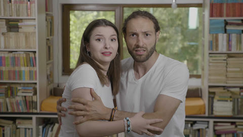 Scared reaction of young couple embracing each other... Stock Video Footage