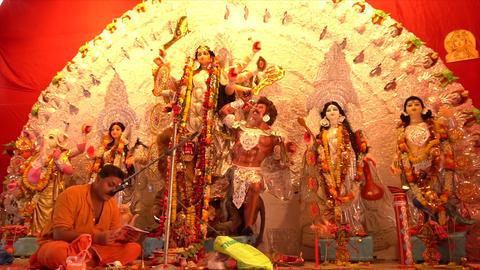 Hindu priest worshipping Goddess Durga Idol, Kolkata, West Bengal, India Footage
