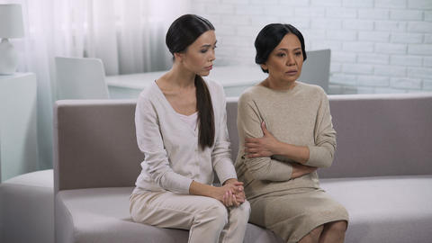 Daughter consoling mother, saying supportive word, giving advice about relations Footage
